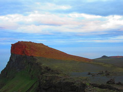 IMG_7247 (NapoleonIsNotDead) Tags: ocean sunset red sun mountain color strange sunshine landscape iceland colorful view top south hill line vik glacier half straight pick shape promontory dyrhlaey cutted reynisfjall myrdalur