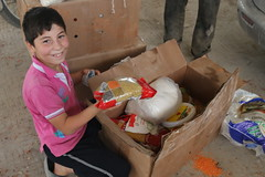 A child in North Hama with Ramadhan supplies for his family (Ummah Welfare Trust) Tags: poverty food children aid hunger syria ramadan humanitarian   humanitarianism