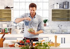 Handsome man cooking at home preparing salad in kitchen. (Vietfuji.techfocus) Tags: people food white man color male home cooking kitchen smile horizontal standing person one photo salad clothing healthy european mood alone adult image good young cook handsome lifestyle vegetable clothes indoors american chef single casual leisure fixing years culinary goodlooking 30s prepare stockphoto cusine caucasian satisfied 3035