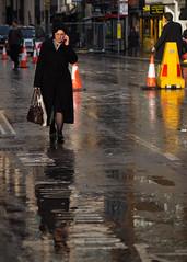 telephone call (Cosimo Matteini) Tags: street woman london rain pen candid olympus aldgate m43 mft telephonecall ep5 cosimomatteini mzuiko45mmf18