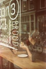Brood @ Utrecht (PaulHoo) Tags: utrecht city citylife urban holland netherlands film lomography colorimplosion analog 35mm leica m3 rangefinder 2016 architecture reflection shop brood bread girl lunch eating people ilobsterit