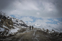 IMG_0543 (Malaya K Pradhan) Tags: travel two sky cloud india mountain snow mountains ice beautiful rain clouds canon skyscape walking landscape drive cloudy walk indian bluesky lookingup frombehind ontheroad sikkim malaya snowcappedmountains twoofakind travelphotography treacherous canon500d indianhills menwalking shotthroughthecarwindow shotthroughthewindow treacherousroads malayapradhan malayakpradhan