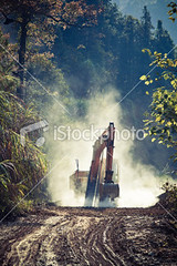 Yellow excavator at construction-site (MPBHAIBO) Tags: china mist tree industry grass forest construction digging smoke horizon working machine nobody mining clay land dirtroad dust contruction constructionsite development quarry bulldozer scoop earthmover  muddyroad buildingactivity  landvehicle horizonoverland