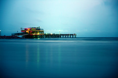 Late Nights on the Water (KatieWhitaker) Tags: ocean longexposure blue beach gulfofmexico water night lights colorful texas dusk vibrant smooth calming galvestonisland tranquil gulfcoast leebigstopper