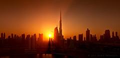 Dubai sunset skyline (Titanium007) Tags: sunset panorama orange horizontal dubai gulf fineart uae middleeast wallart arab unitedarabemirates arabiangulf godrays dubaiskyline emaar dubaibuildings businessbay dubaiarchitecture burjdowntown dubaiskyscrapers dubaitowers theaddress sheikhzayedroadskyline burjkhalifa dubailandmarks