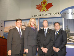 Michael announces a $6.6 million contract between the Department of National Defence and Georgetown-based Patlon Aircraft & Industries Ltd., alongside (L-R)  Labour Minister Lisa Raitt, Patlon President Patrick Mann, and Patlon Vice-President Stephen Mann