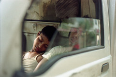 Come, Let's Take a Nap... (Sheikh Shahriar Ahmed) Tags: street light sleeping sun film car analog work children 50mm nikon ray child sleep candid streetlife pickup fujifilm dhaka f18 bangladesh banasree nikonf6 af50mmf18d fujicolorc200 dhakadivision sheikhshahriarahmed