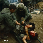 February 1968, Hue - U. S. Marine medics treat a wounded fellow Marine whose face is almost completely covered with blood. thumbnail