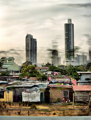 A vision of Panama (Giorgio Verdiani) Tags: auto city sky people motion building slr car clouds digital america skyscraper town reflex highway automobile nuvole skyscrapers gente zoom taxi digitale blurred running olympus cielo panama grattacielo zuiko panamacity slum 8mp slums shantytown correndo citt mosso costruzioni e500 grattacieli bidonville superstrada