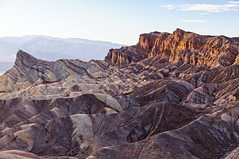 Zabriskie Point (Lars Peter Lundstrm Photography - Denmark, DK) Tags: california park travel sunset sky terrain usa mountain mountains southwest color nature rock stone point landscape outdoors death twilight sand place desert dusk famous nevada extreme hard dramatic peak dry national valley environment deathvalley geology zabriskiepoint range sedimentary climate scenics crevice eroded destinations