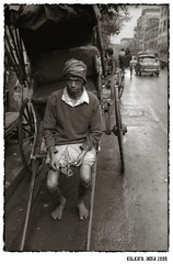 rickshaw puller (hindustanpics) Tags: street travel portrait people blackandwhite bw india white black blancoynegro film monochrome analog asia noir noiretblanc documentary analogue weiss kolkata schwarz calcutta