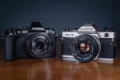 Camera Generations (trm42) Tags: camera slr film analog olympus generations om omd em1 om4ti strobist mirrorless valaisija