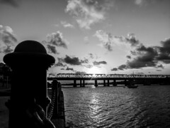 Sydney Harbour Sunset (alwaysinsydney) Tags: ocean light sunset sky sunlight white black reflection water monochrome clouds landscape boats bay pier seaside iron harbour cove sydney bridges australia wharf yachts silhoutte