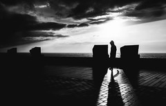 It's getting dark (Dan-Schneider) Tags: street camera trip light shadow sea sky people blackandwhite bw silhouette photography prime europe streetphotography olympus scene best moment schwarzweiss decisive schneider 17mm momochrome mft einfarbig omdem10
