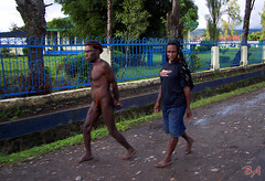 Watch your eyes and keep walking girl! (Benisius Anu) Tags: papua indonesia jayapura wamena koteka tribe tribal