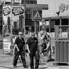 Make it happen (John Riper) Tags: street people bw white black men netherlands monochrome bike bicycle june metal architecture lady canon fence john poster square photography mono rotterdam zwartwit candid xmen l month ret tribune karel doorman pathe 6d 24105 2016 heras straatfotografie vandenheuvel doormanstraat riper johnriper photingo