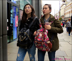 `1699 (roll the dice) Tags: london westminster w1 westend oxfordstreet asian chinese korean sexy pretty girls rush blur people natural fashion shops shopping streetphotography movement londonist uk art classic urban england unaware unknown strangers candid portrait canon tourism sad mad fun happy wisdom boots iphone apple mobile phone talk bags flag ripped jeans denim glasses lips kiss mouth