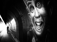 face to face (Sandy...J) Tags: street city light urban bw sunlight white black art face silhouette wall backlight germany dark underpass walking bayern deutschland photography mono licht blackwhite women gesicht noir alone fotografie grafitti darkness walk wand streetphotography atmosphere tunnel olympus stadt sw monochrom frau passage altstadt atmosphre stimmung mauer bavarian gehen gegenlicht dunkelheit wandmalerei unterfhrung spazieren allein sonnenlicht schwarzweis strasenfotografie