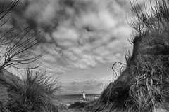 blind man's profession (Tony Shertila) Tags: sky lighthouse weather wales clouds coast sand europe day cloudy britain outdoor dunes tallin 20160405110228