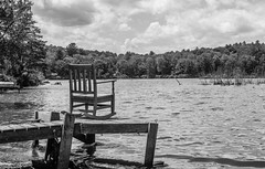 Rocking By The Lake In Black And White (Catskills Photography) Tags: blackandwhite lake water landscape chair rockingchair hbm canon35mmf2lens