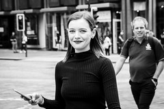 If In Doubt, Smile (Leanne Boulton) Tags: life street city uk light shadow portrait people urban blackandwhite bw woman white black detail texture girl monochrome beautiful beauty smile face smiling female contrast canon 50mm mono scotland living blackwhite eyes eyecontact soft pretty natural emotion humanity bokeh outdoor expression glasgow candid grain young culture streetphotography streetlife scene depthoffield human shade portraiture 7d feeling society tone facial candidportrait candidstreetphotography candideyecontact