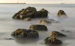 Rocks (Preston Ashton) Tags: ocean sea england lighthouse water pier boat rocks long exposure waves sailing ship sail southshields prestonashton