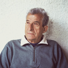 Portrait of a senior man (Nasos Zovoilis) Tags: life park old summer portrait sky people white man male men green film nature senior smile face look field standing work hair season fun outside outdoors happy person grey one countryside spring healthy eyes alone village hand looking adult natural emotion serious outdoor expression farm father country joy poor grandfather lifestyle happiness hasselblad human mature elderly older worker leisure daytime years aged farmer mustache agriculture 80 retired unhappy retirement active peasant wrinkled caucasian pensioner fuji400h