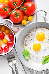 Two fried eggs rustic breakfast (kasha_malasha) Tags: old morning two food white hot color cooking yellow metal breakfast rural vintage silver tomato circle table wooden healthy couple iron eating fat rustic egg plate fork bowl eat rack rosemary meal heat garlic eggs basil ready pan organic portion cooked fried oregano protein yolk frying ingredient trivet cholesterol