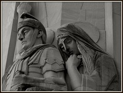 Sculpture: A Woman Leans on A Centurion, National Shrine of the Little Flower--Royal Oak MI (pinehurst19475) Tags: two blackandwhite bw sculpture church michigan deux catholicchurch zwei sculptor royaloak romancatholic monumental woodwardavenue sculpturalrelief nationalshrineofthelittleflower charlescoughlin fathercharlescoughlin renepaulchambellan woodwardsights crucifixiontower woodwardattwelvemileroad woodwardattwelvemile