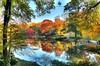 Autumn Reflections @ Central Park (Daniel Portalatin Photography) Tags: park bridge autumn trees sky newyork art fall water colors canon landscape outdoors photography rocks cityscape manhattan fineart fine scenic foliage anawesomeshot t2i danieljportalatonphotography