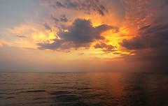 fire (Nikos Tzitzikostas) Tags: sunset top20sunsetsofourhearts clouds sea greece