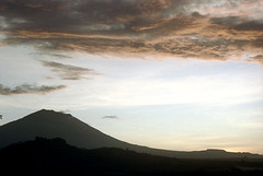 24-573 (ndpa / s. lundeen, archivist) Tags: sunset sky bali mountain color film field clouds rural forest 35mm indonesia landscape volcano evening dusk nick hills southpacific fields 24 1970s 1972 indonesian balinese dewolf oceania pacificislands nickdewolf photographbynickdewolf reel24
