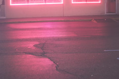 December 23rd (Illuminated Bones) Tags: pink light hot reflection colors rain weather fog night photography lights neon bright cement foggy gravel