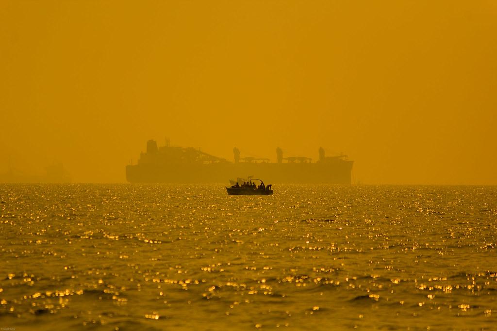 ocean sunset sea india beach water evening boat ship goa transportation
