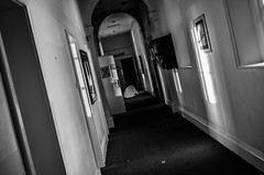 URBEX - Bridge Hotel (karllaundon) Tags: bw history abandoned architecture hospital way mono hall decay telephone corridor care passage derelict remains damp clerical