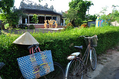 Outside the pagoda (Roving I) Tags: gold bikes dragons buddhism villages vietnam bicycles baskets hue hedges beliefs conicalhats