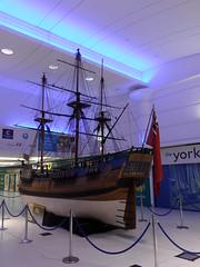 Endeavour Centre (Nekoglyph) Tags: blue white mall shopping boat wooden model ship flag redensign replica publicart middlesbrough masts jamescook endeavour clevelandcentre