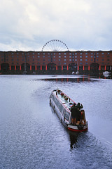 Coming into the Albert Dock (colinpoe) Tags: water liverpool mediumformat boat cityscape ferriswheel 6x9 albertdock canalboat urbanlandscape 620 medalist medalistii kodakmedalist ektar100 ektarlens kodakektarfilm