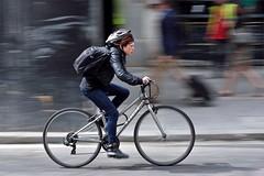 A sense of urgency (jeremyhughes) Tags: bike vehicle wheel london cyclist cycling commuter commuting street road bicycle wheels helmet hurry rush speed panning motion movement woman nikon d750 nikkor 80200mmf28d explore