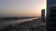 Abu Dhabi #2 (Digital Adrian) Tags: camera city travel sunset sky urban building glass smart river out point landscape evening twilight construction shoot cityscape phone view dusk earth g united horizon uae wide cell engineering screen emirates smartphone arab motorola moto format straight abu dhabi 169 scraper sooc motorolamotog