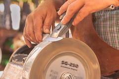 Velocidad (Nathalie Le Bris) Tags: speed hands market knife manos mercado motionblur velocidad mains marché vitesse cuchillo mende couteau afilador rémouleur