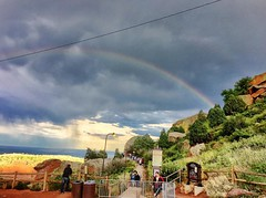 Rainbow over Red Rocks, 2015.07.15 (Aaron Glenn Campbell) Tags: summer vacation sunlight rain weather rainbow parkinglot colorado roadtrip faded shade redrocks morrison excursion stormcell concertgoers iphoneography instagramapp uploaded:by=instagram snapseed vividhdr ios8 iphone6plus