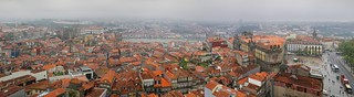 The Torre dos Clérigos overlooks the rooftops of Porto on a misty and wet day