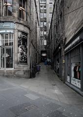 Edinburgh (buddythunder) Tags: travel europe 2016 wideangle scotland edinburgh uk muted royalmile desaturated alley lane alleyway window shop shops sidewalk paving stones shadows