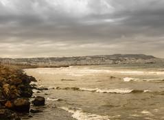 La baie d'Alger (zhadjam) Tags: seascape sandandsea landscape cityscape water rocks sunset gloomy cloudy art algiers surreal artphotography nature flickrnature beautifulnature