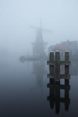 Adriaan in de mist (zsnajorrah) Tags: urban reflection haarlem water netherlands windmill spaarne fog transportation zuidam efs1785mm deadriaan eos600d