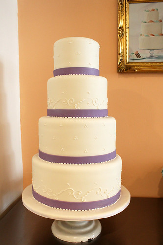 Simple Wedding Cake with Purple Ribbon and Small Piping