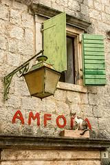 croatian cat (maryannenelson) Tags: building animal cat streetlamp croatia ledge shutters