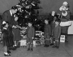 Christmas at the cinema (theirhistory) Tags: uk girls england boys hat socks kids children toys shoes uniform dress sandals clothes suit jacket dressingup presents bow shorts wellies