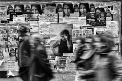 La mirada (una cierta mirada) Tags: street people bw motion glasses spain streetphotography gaze soria bnw cartel artlibre